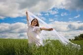 Beautiful girl with flying white shawl — Stock Photo
