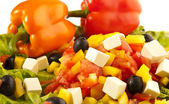 Greek salad with peppers closeups — Stock Photo