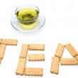 A cup of tea with cracker — Stock Photo