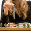 Woman's hands with key and toy house — Stock Photo