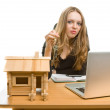 Businesswoman with keys and toy house at office — Stock Photo