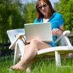 Woman enjoying the sun — Stock Photo #9442250