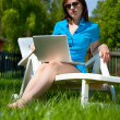 Woman with laptop  outdoors — Stock Photo