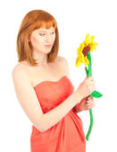 Beautiful woman with toy flower isolated on white — Stock Photo