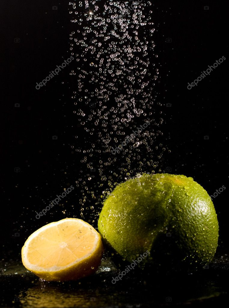 Lime under sparking water jets — Stock Photo #9442341