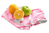 Oranges, green apple, tape measure and pink panties — Stock Photo