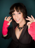 Picture of a young woman in jacket and pink gloves — Stock Photo