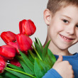 Young boy holding tulips — Stock Photo