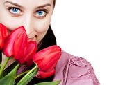 Woman with rad tulips bouquet — Stock Photo