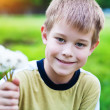 Smiling boy with dandelions — Stock Photo