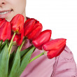 Girl with rad tulips bouquet — Stock Photo