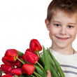 Happy boy holding tulips — Stock Photo