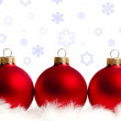 Three red Christmas tree balls - Stock Photo