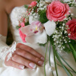 Colorful wedding bouquet at bride's hands — Stock Photo