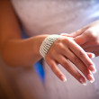 Beads in woman hand — Stock Photo