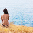 Girl on the sea coast - Stock Photo
