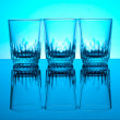Glases isolated on blue background — Stock Photo