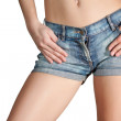 Sexy woman body in jean shorts — Stock Photo
