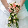 Bridal bouquet in the the bride's hands — Stock Photo #8602789