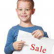 Smiling boy holding paper blank — Stock Photo