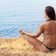 Stock Photo: Beautiful girl in meditation on beach