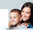 Mother and  son  working using laptop — Stock Photo