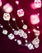 Beads on cherry background — Stock Photo