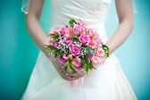 Bridal bouquet in the the bride's hands — Stock Photo