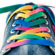 Bright colorful shoelace and sneakers — Stock Photo