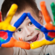 Child showing his colored hands — Stock Photo