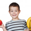 Little Boy holding fruit — Stock Photo