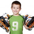 Little beautiful boy with roller skates — Stock Photo