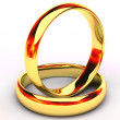 Isolated gold wedding rings — Stock Photo