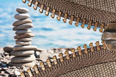 Zipper with sea pebbles background — Stock Photo