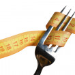 Measuring tape on a fork — Stock Photo