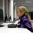 Little girl use computer in a library — Stock Photo #10052652