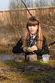 Teen Girl Recording Geocaching logbook — Stock Photo