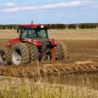 Tractor cultivated field — Stock Photo