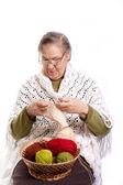 Senior woman knitting — Stock Photo