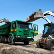 Stock Photo: Two excavators loaded dumper