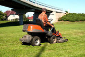 Man on a Lawn Tractor — Stock Photo