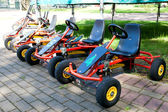 Children go carts in city park — Stock Photo