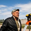 Royalty-Free Stock Photo: Theodolite on a tripod with construction worker