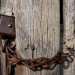 Stock Photo: Rusted lock and chain