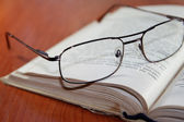 Old books with glasses — Stock Photo