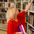 Woman in library — Stock Photo