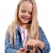 Girl with a touchscreen phone — Stock Photo