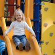 Girl On A Playground Slide — Stock Photo