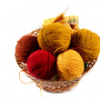 Colored wool balls in wicker basket — Stock Photo
