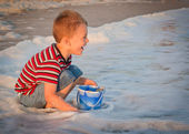 Boy drinking from fountain — Stock Photo